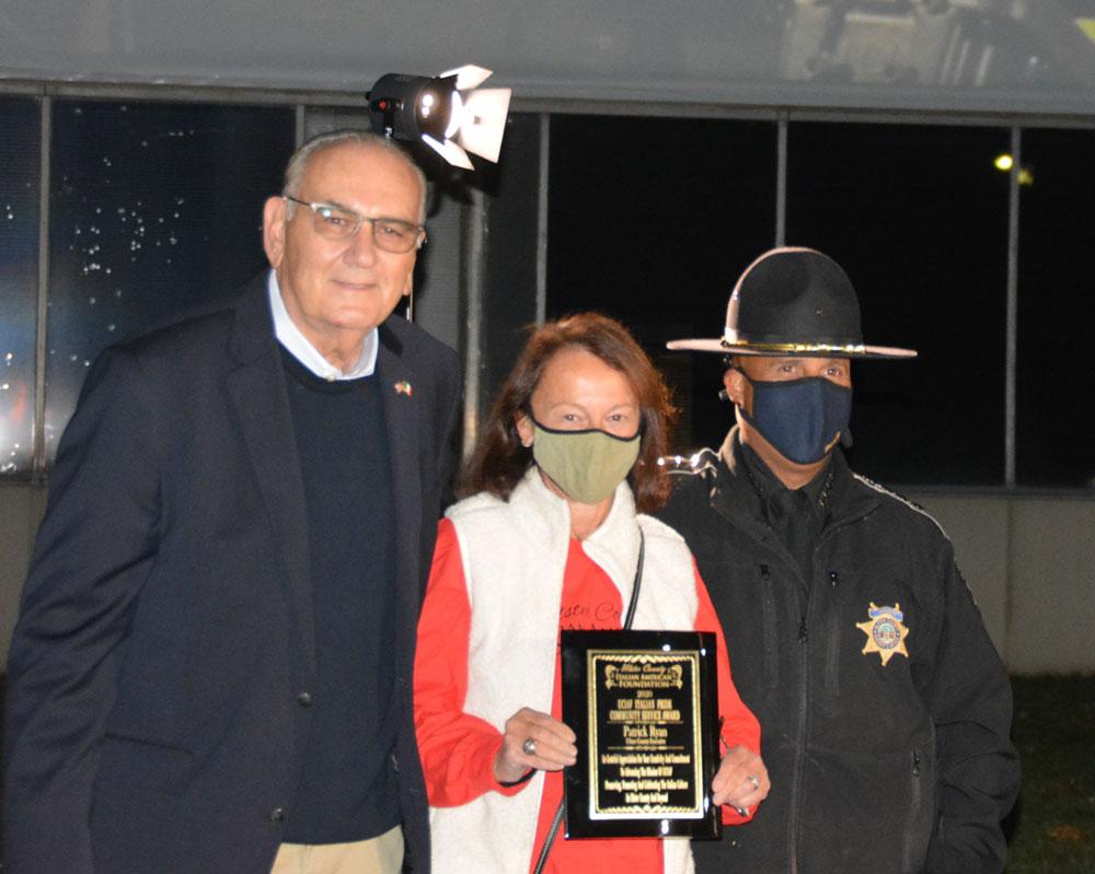 County Award to Sheriff Figuera Nina Postupack and Les Lombardi